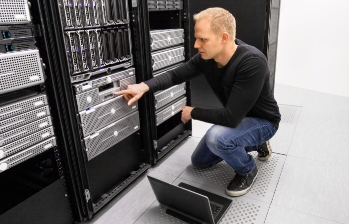 It consultant work with laptop in datacenter 670988516 2500x1667 1