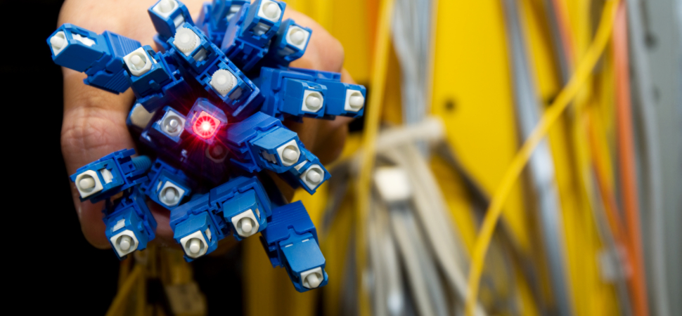 Electrical engineer holding a bunch of fiber optics 157396052 4288x2848